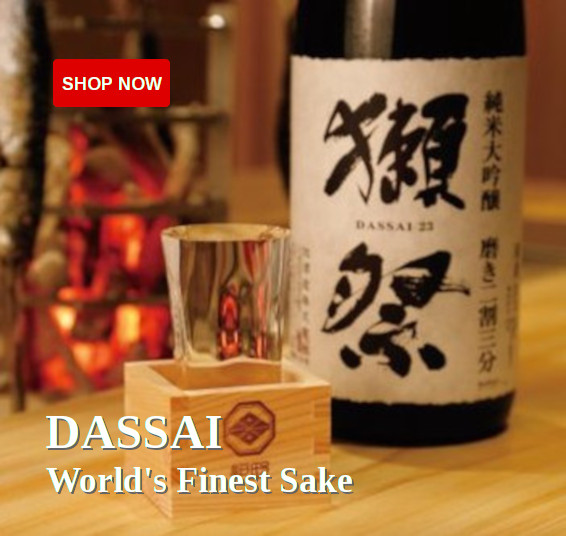 A bottle of Dassai 23 next to a masu